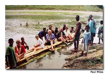 Some of the intrepid travelers board the bilibili (bamboo raft) for a leisurely cruise down the backwaters of the Sigatoka River.